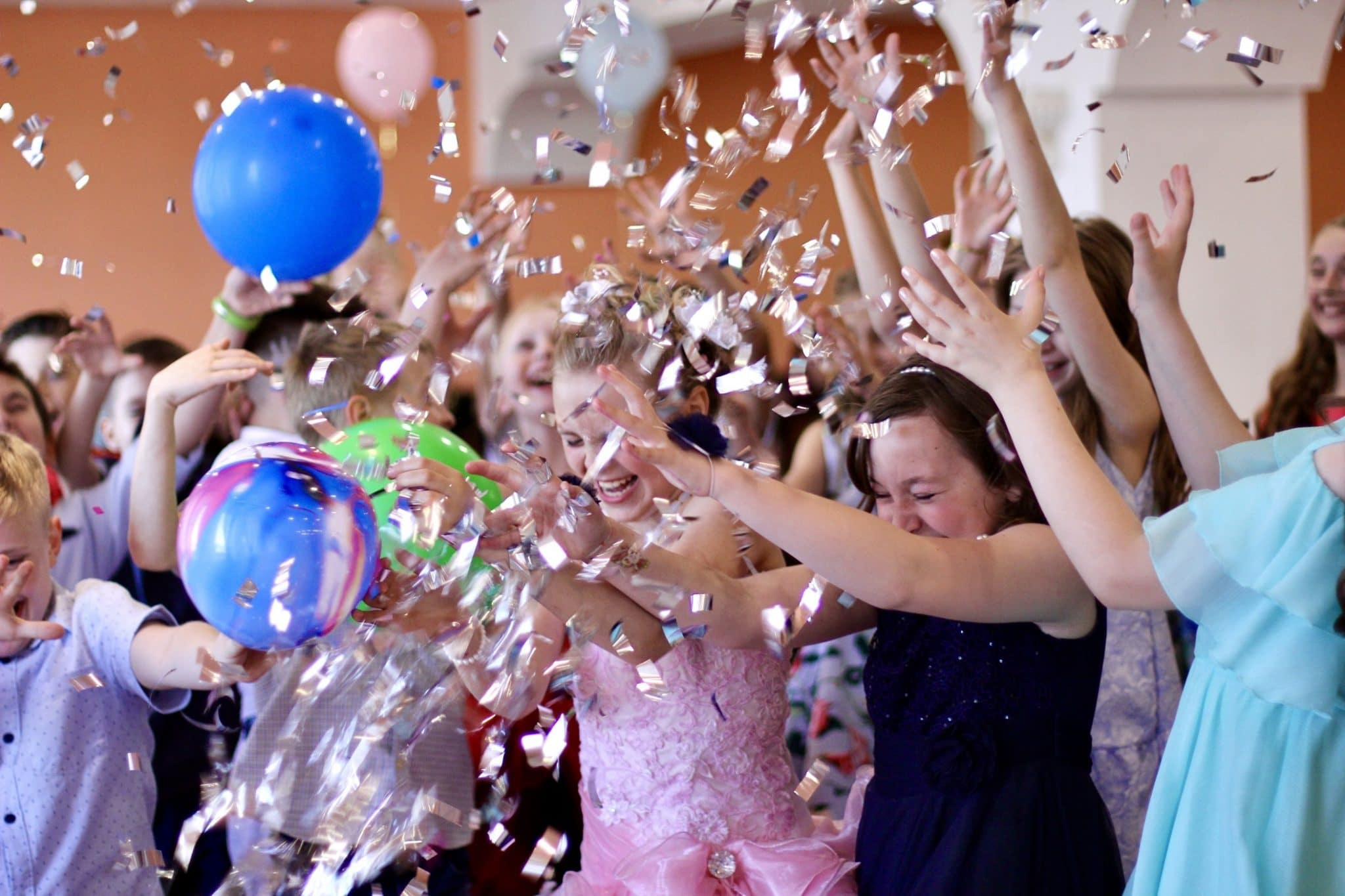 kids-having-fun-at-a-childrens-party-in-the-rain-of-shiny-confetti-celebrate-togetherness-boys-pupils_t20_QzZn9j