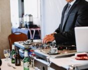 dj-playing-music-at-a-party-celebration-wedding-dancing-dance_t20_vKrAvv
