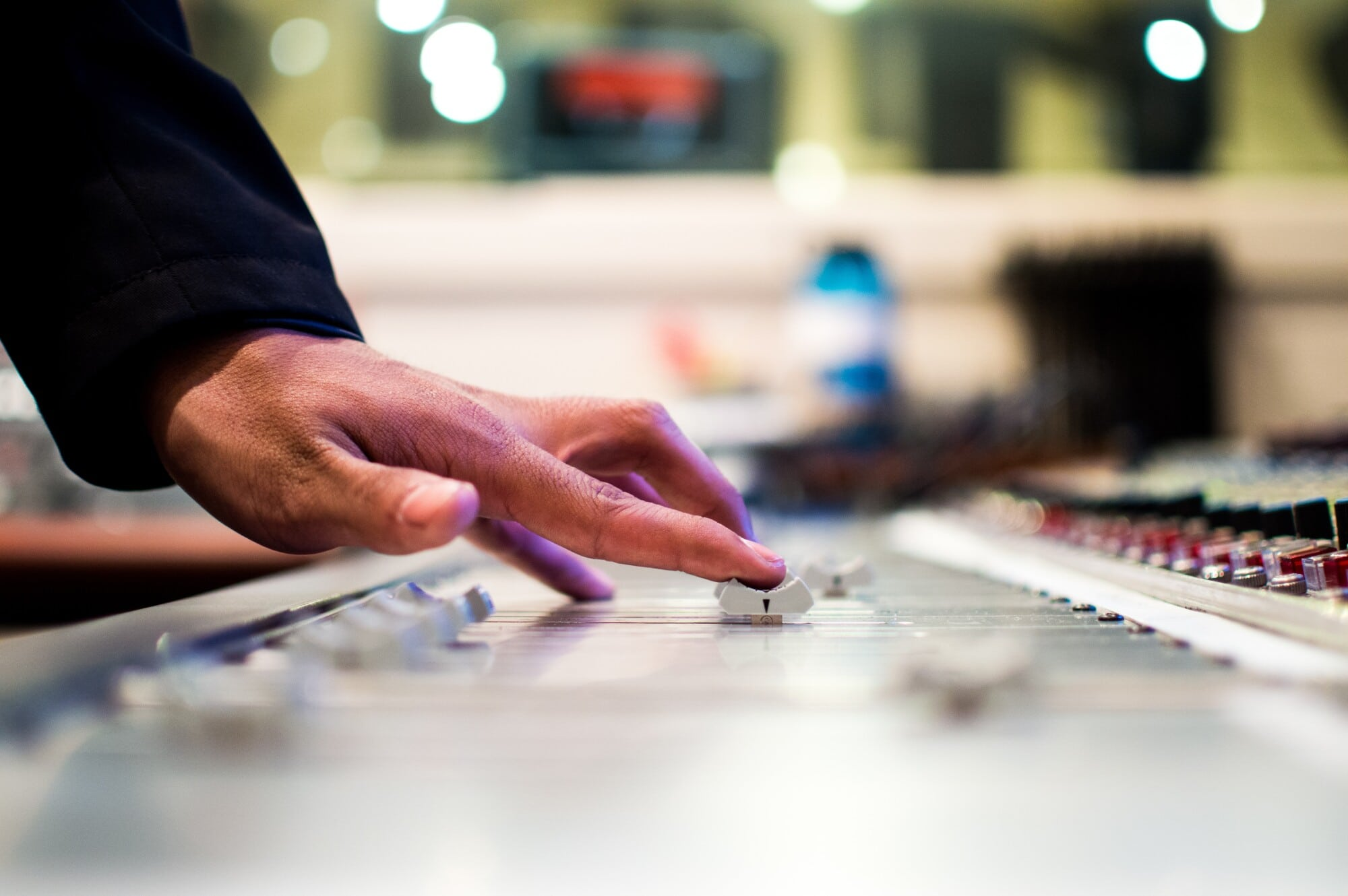 Wedding DJ conducting a sound check on the sound board