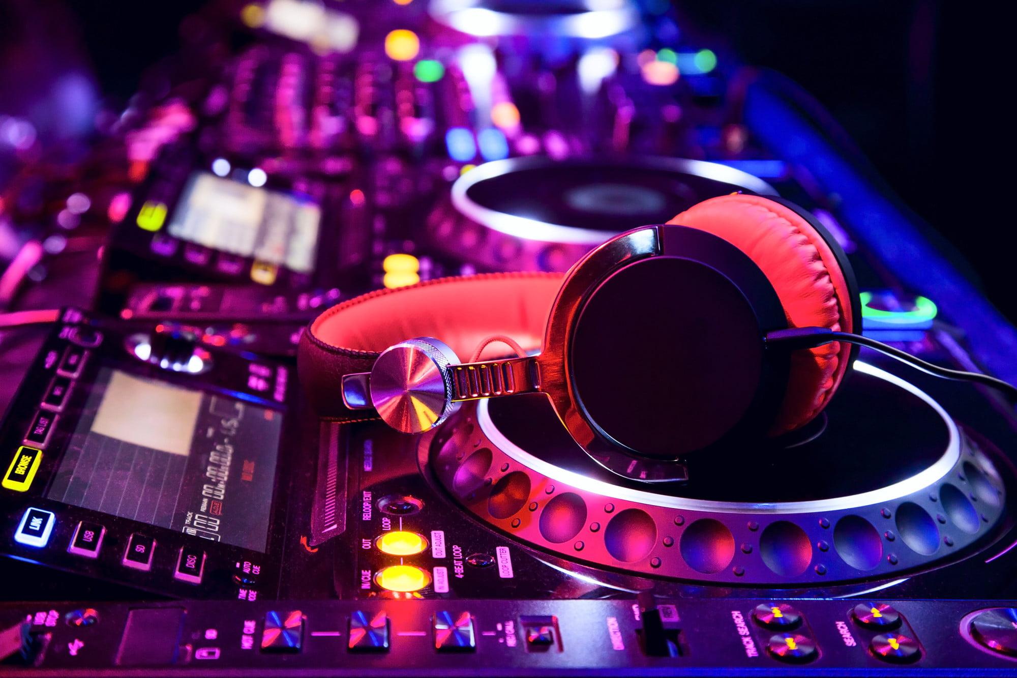 Headphones laying on a Wedding DJ sound mixer